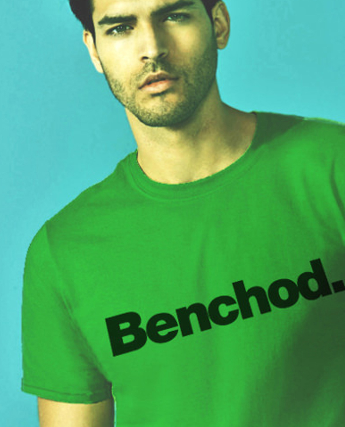 South Asian male model wearing Benchod. green SoftStyle South Asian Desi Themed Graphic Design t.shirts by Brown Man Clothing Co.