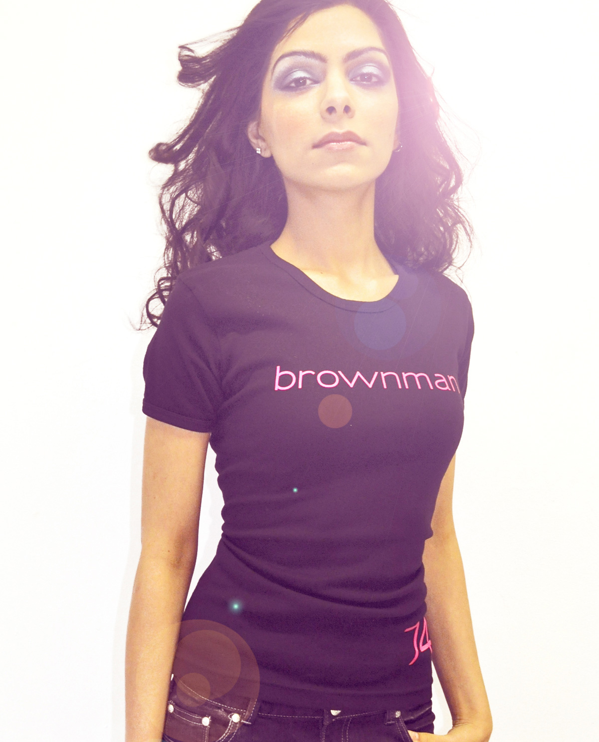 South Asian female model wearing black fitted American Apparel brownman74 tshirt by Brown Man Clothing Co.
