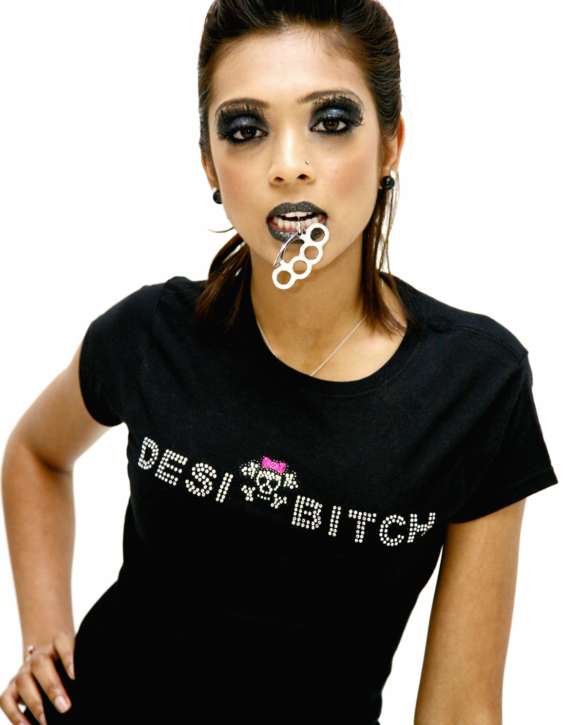South Asian female wearing Desi Bitch rhinestone shirt.