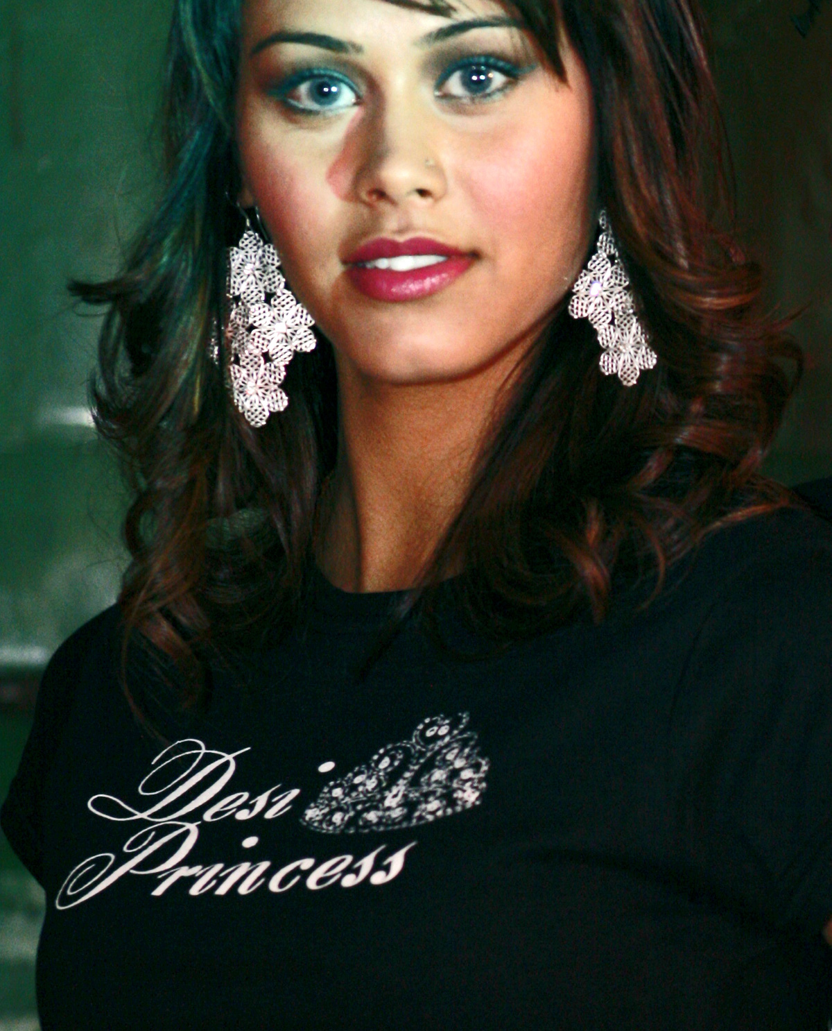 South Asian Female Model wearing Desi Princess T.shirt on Black Fitted shirt. Graphic design t.shirts by Brown Man Clothing Co.