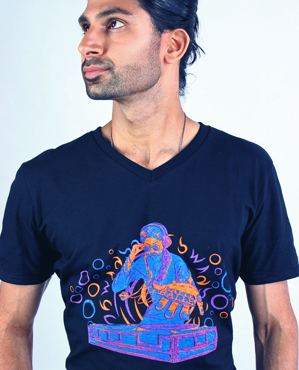 South Asian Male Model wearing full colour graphic design tshirt on black v neck fitted t-shirt by Brown Man Clothing Co.