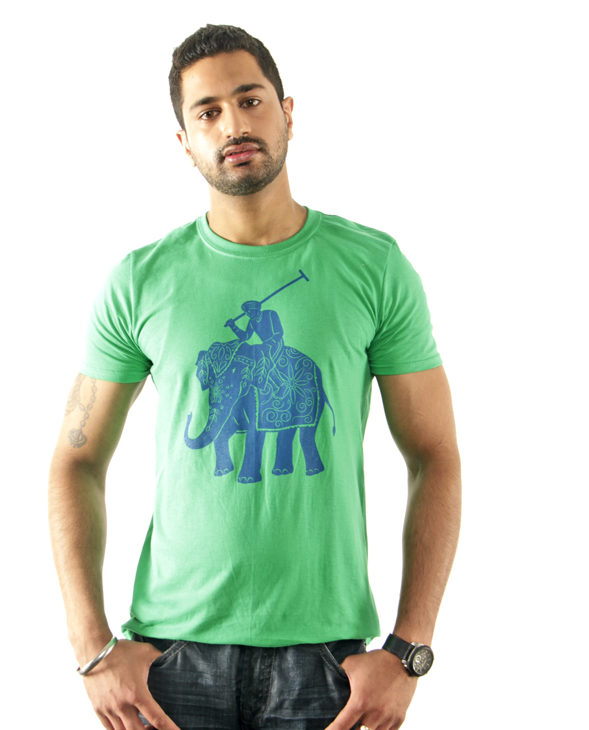 South Asian male model wearing SoftStyle green Elephant Polo t.shirt. South Asian Desi Themed Graphic Design t-shirt collection by Brown Man Clothing Co.