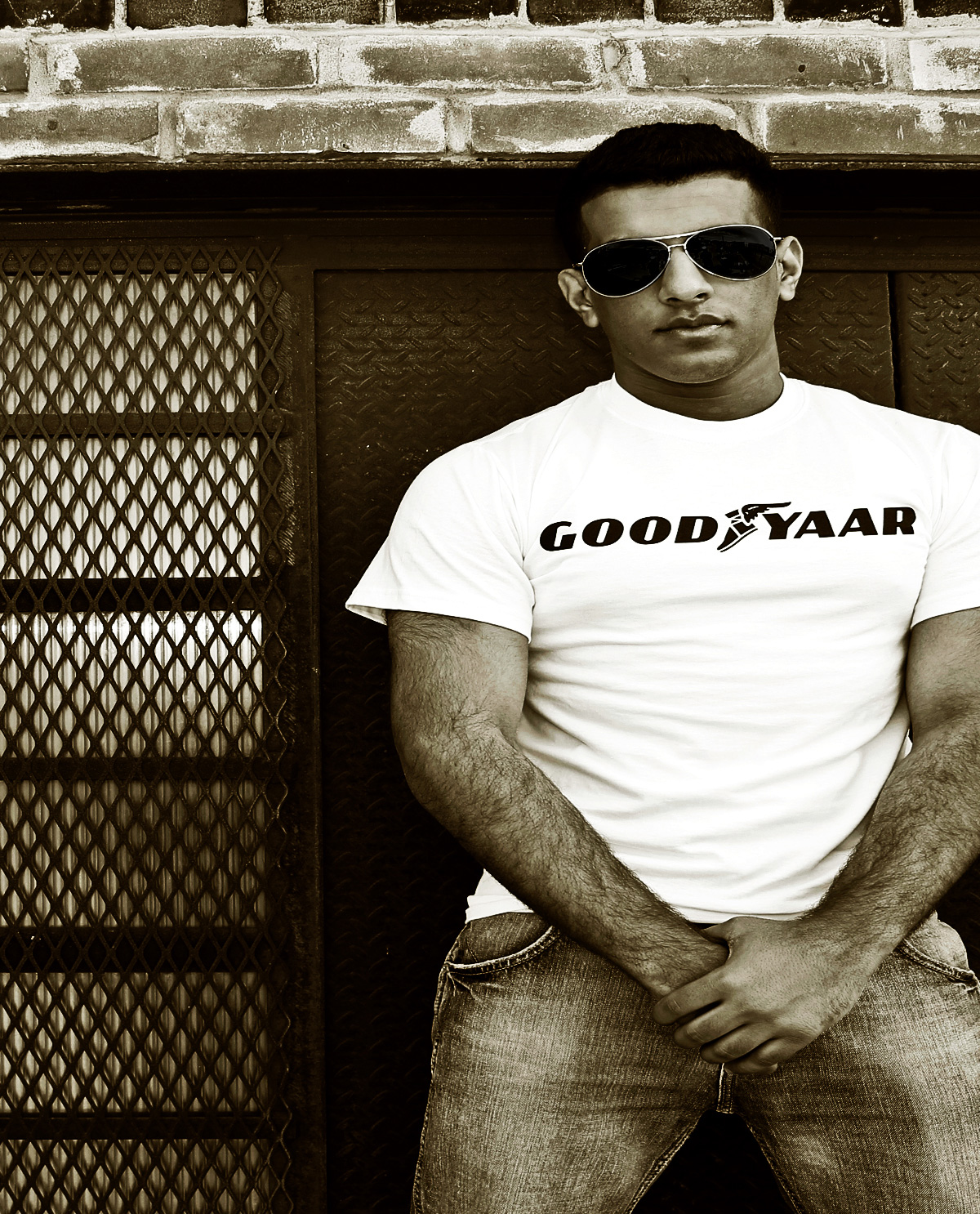 South Asian male model wearing white t.shirt with Graphic Design letter on front that says Good Yaar.  South Asian Desi Themed Graphic Design t.shirts by Brown Man Clothing Co.