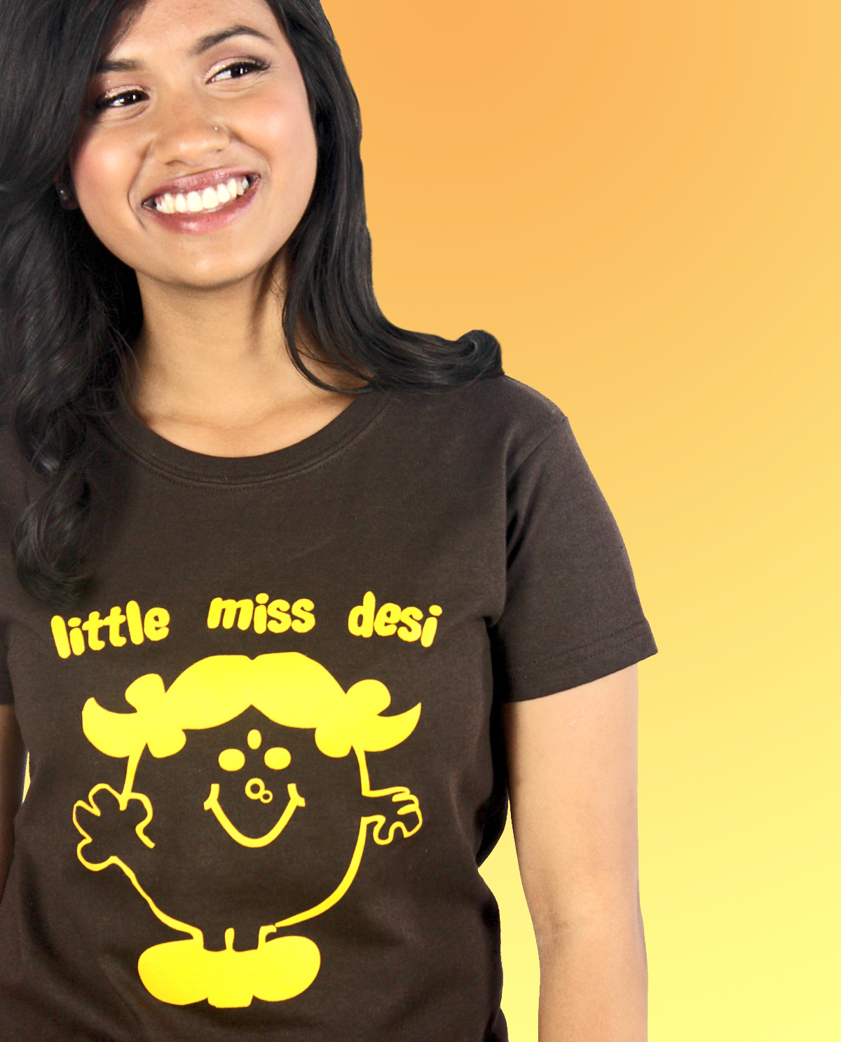 South Asian Female Model wearing Graphic Design T.shirt with Little Miss Desi graphic design on front.