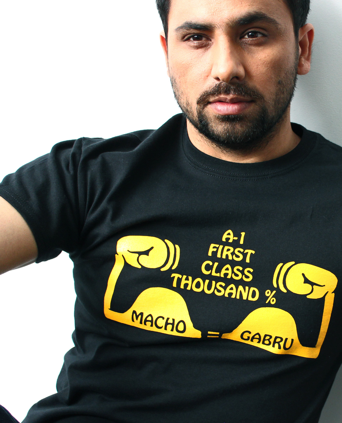 Macho Grabru graphic design t.shirt being worn by South Asian male model. South Asian Desi Themed Graphic Design t.shirts by Brown Man Clothing Co.