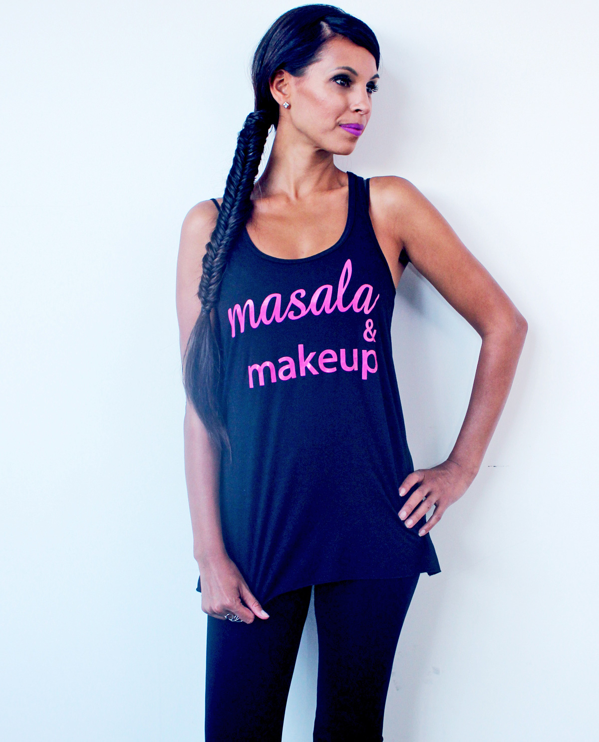 South Asian female model wearing racerback black tank top with Masala & Makeup written on front. South Asian Desi Themed Graphic Design t.shirts by Brown Man Clothing Co.