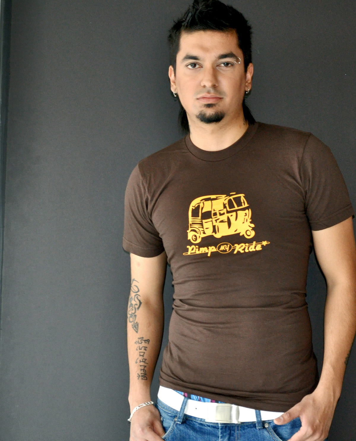 South Asian male model wearing Pimp My Ride illustrated design printed on SoftStyle brown American Apparel Jersey T.shirt fitted t.shirt. South Asian Desi Themed Graphic Design t.shirts by Brown Man Clothing Co.