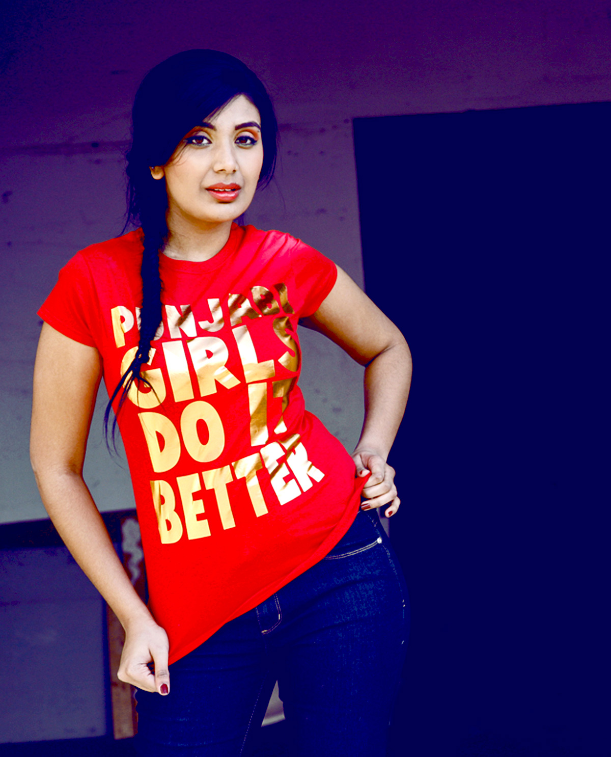 South Asian Female Model wearing Red Copper Foil Lettering T.shirt on Red Fitted shirt that says Punjabi Girls Do It Better. Graphic design t.shirts by Brown Man Clothing Co.