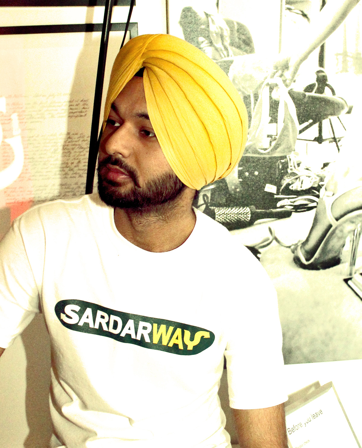 South Asian male model wearing white t.shirt with Graphic Design illustrated design on front that says SardawWay.  South Asian Desi Themed Graphic Design t.shirts by Brown Man Clothing Co.