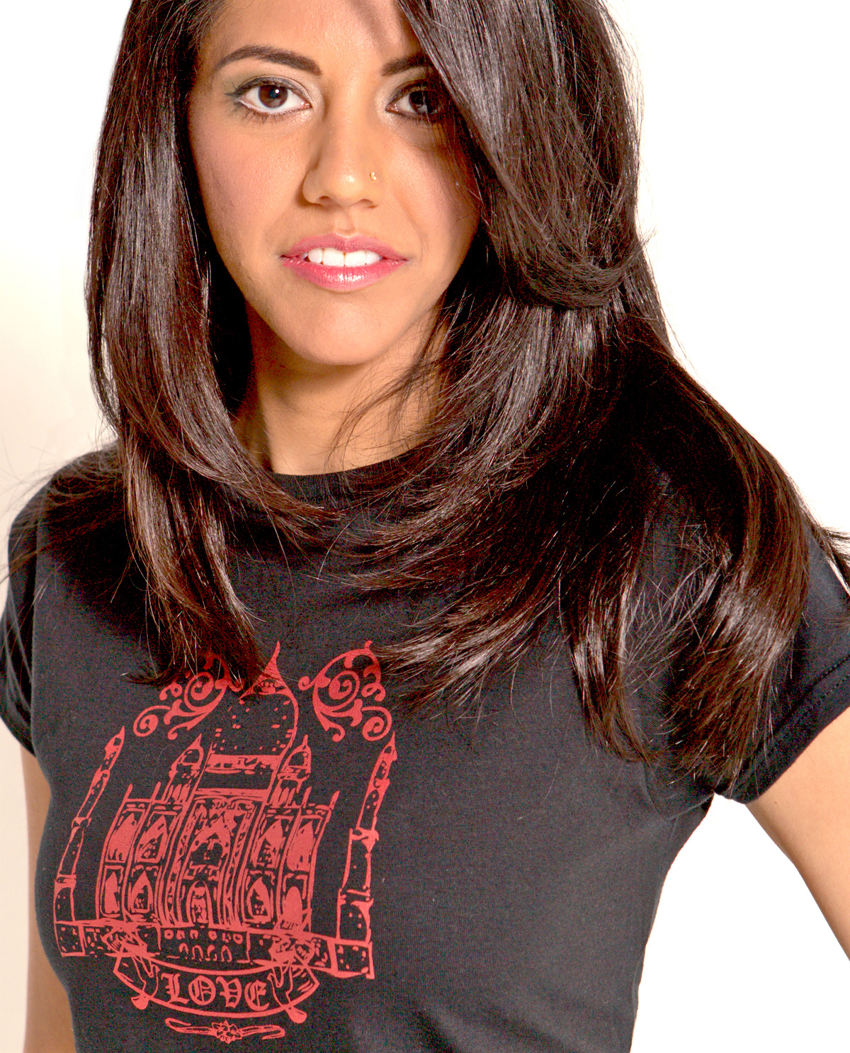 South Asian female model wearing black fitted graphic design t.shirt with image of Taj Mahal on front. Designed by Brown Man Clothing Co.