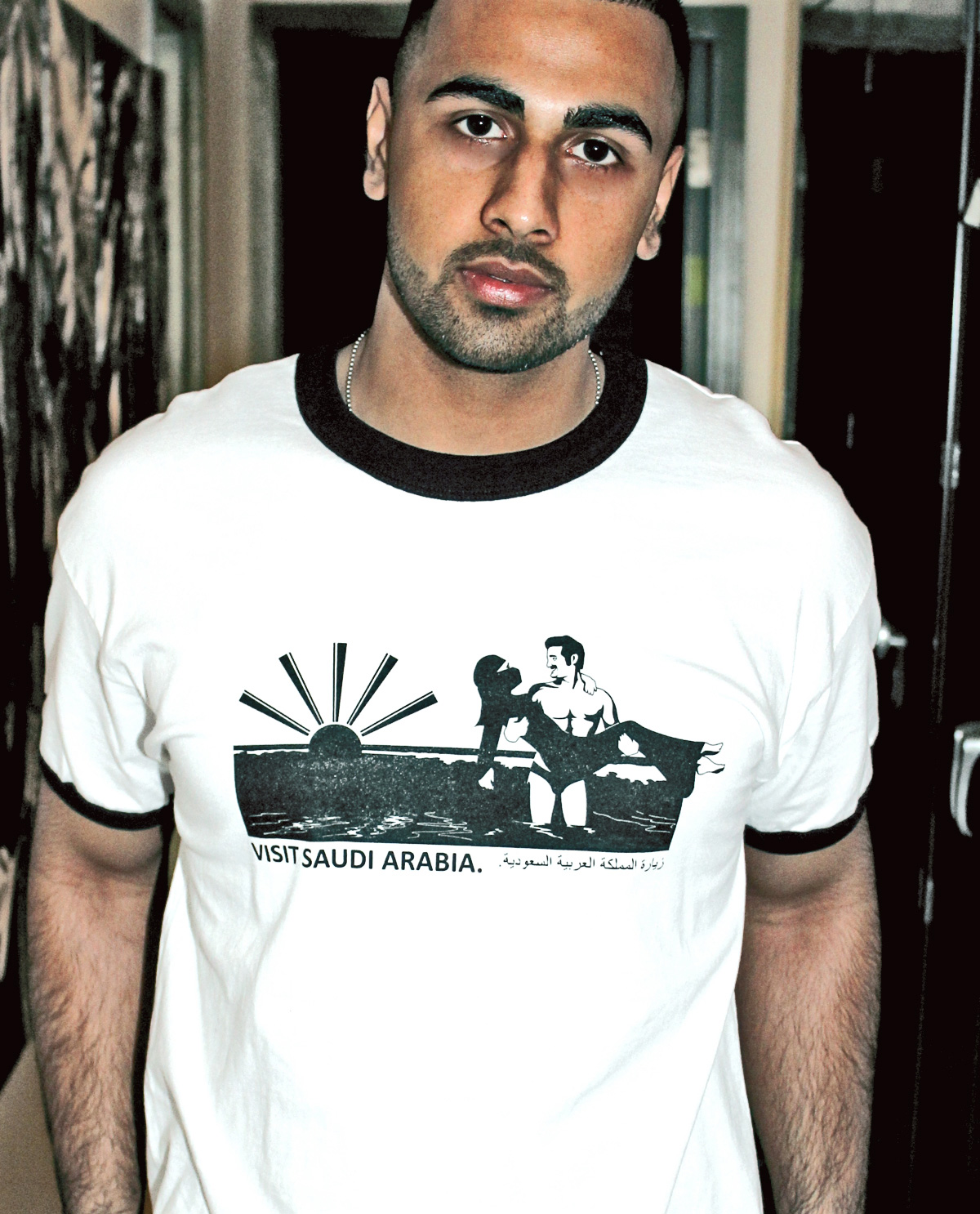 Visit Saudi Arabia Graphic Design T.shirt printed on white and black ringer t.shirt by Brown Man Clothing Co.